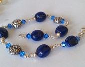 Deep Blue Lapis Lazuli and Fine Silver Swirly Gastropod Shell  Bracelet