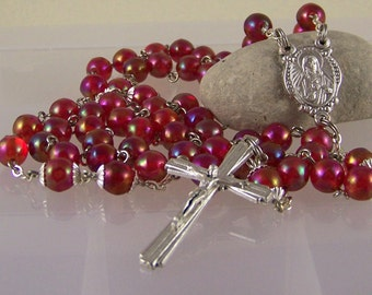 handmade Catholic rosary with cranberry red glass beads in silver
