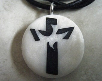 Cross with dove hand carved on a polymer clay mother of pearl color background. Pendant comes with a FREE Necklace