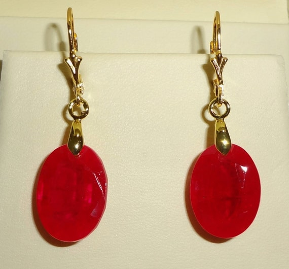 33 cts Genuine Oval Facted Red Sapphire stones, 14kt yellow gold leverback pierced earrings