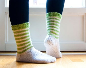 Hand knit white socks with green stripes. Knitted in durable wool blend yarn.