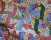 Patchwork diamonds and blocks quilt