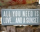 Love and A Sunset Beach Sign
