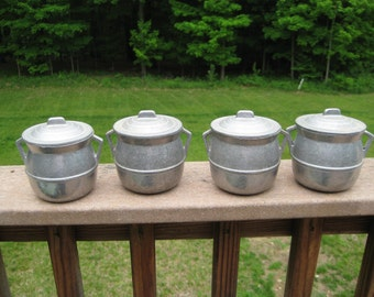 Four Cast Aluminum Containers with Lids