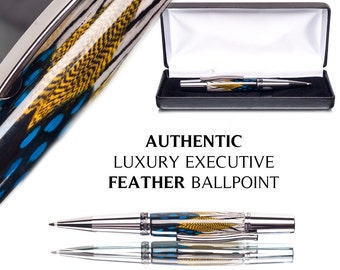 Ballpoint pen made with feathers cast in crystal clear acrylic