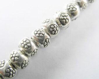 10 of Karen Hill Tribe Silver Daisy Imprint Beads 6x4.5mm. mm. :ka3344