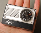 Vintage mechanical watch, alarm clock, miniature radio,
