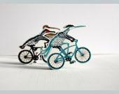 Bird on bike brooch, cycling Heron pin, blue