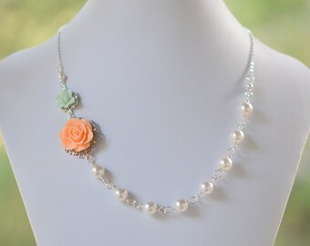 Bridesmaid Necklace. Wedding Party Jewelry.  Peach Rose and Mint Lotus Asymmetrical White Pearl Necklace.  Fashion Rose Necklace.