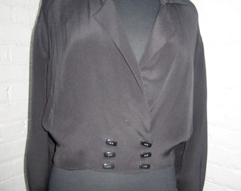 Black silk cropped jacket  with rectangular buttons.