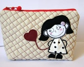 trousse , pochette, cosmetic bag with the application in fabric