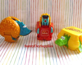 Vintage McDonald's Toys, Dinosaurs, Robots, Changeables, Transformers, Chicken McNugget, French Fries, Cheeseburger, 3 in lot, Food Toys