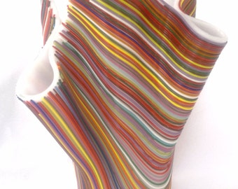 A colorful freeform strips glass vase handmade by dalit glass