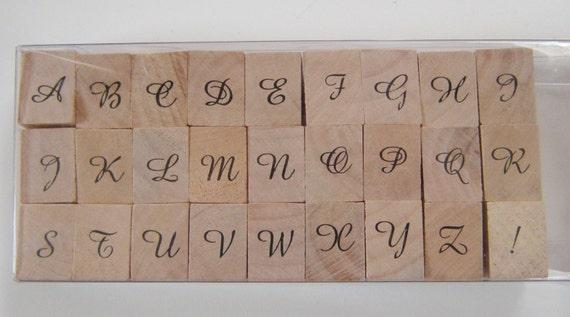 Letters of The Alphabet in Script Script Capital Letters