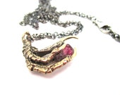 The Hunted - Bronze crow claw pendant with pink tourmaline stone
