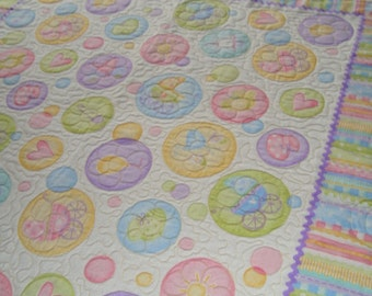 Baby panel  quilt with bright colors circle pattern.