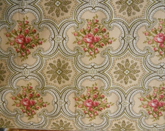 Bella Marcus Brothers Beautiful Dark peach to orange roses with hits of green in quatrefoils with madalions on cream back ground 1 yard
