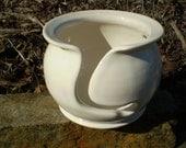 White glazed yarn bowl with 4 holes.