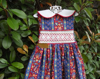 Blue and Red Sleeveless Cotton Dress Hand Smocked in Red, Blue and Yellow.