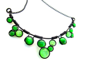 Emerald Green and Black Wire wrapped necklace with bright green cat's eye beads, black wire and adjustable chain