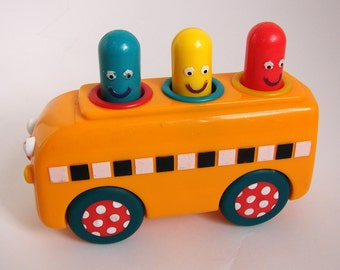 Vintage SASSY child's Toy Bus 1970s 80s squeaky roll along pop up interactive wee men fun retro decor