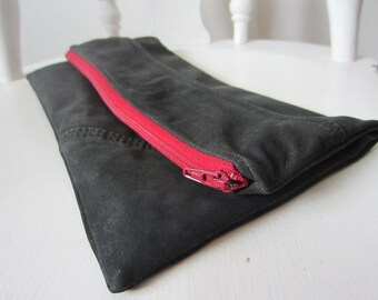 black leather clutch with dark red zipper and matching interior , eco-friendly