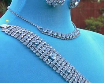 Parure blue rhinestone necklace , earrings, and bracelet in silvertone
