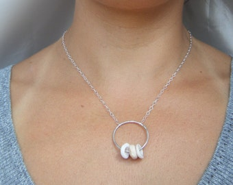 Sterling Silver Puka Shell O Necklace.