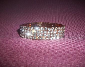 Stretchy Bracelet Sparkling Four Rows Of White Rhinestones On Copper