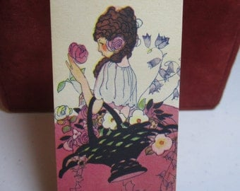 Art Deco 1920's unused Buzza Craftacres bridge tally card beautiful girl with basket full of flowers holding a pink rose