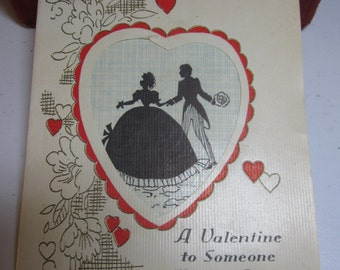 Vintage 1930's die cut gold gilded valentine card silhouette of victorian couple in elaborate