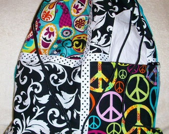 peace and paisley on a teal ripstop nylon drawstring backpack with front zipper pocket