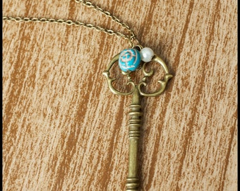 Antique Brass Skeleton Key Necklace with Blue Rose Bead and Pearl Bead