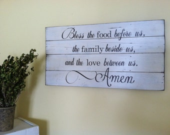 Bless the food before us, family beside us, and love between us. Painted on barn wood.