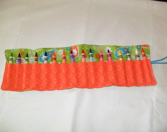 Green and orange crayon roll