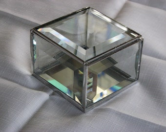 Clear beveled glass box  3 x 3 inches square, 2 inches deep with a hinged beveled glass lid