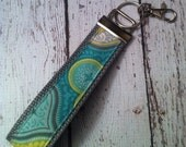 Blue Moroccan style print key fob wristlet on grey cotton webbing with swivel lobster clasp