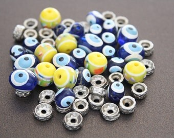 55 Assorted clay beads and connectors