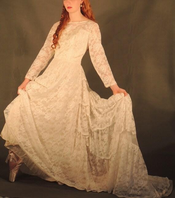 Lace wedding dress cascading victorian bustle train