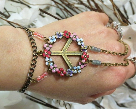 """Rainbow Peace """"Slave Bracelet"""" Ring. Glittery colorful Flower Peace Sign Charm. Colorfully beaded Adjustable as is. Fits wrist 6 to 8.5"""""""