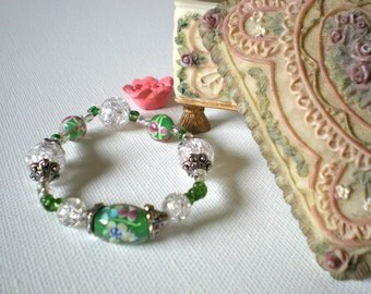 Green lampwork bead bracelet with small pink flower accents