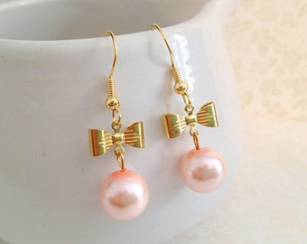 Gold Bows and Light Pink Pearl Dangle Earrings. Romantic. Cute. Feminine. Small Bows. Bow Earrings. Spring. Under 20.