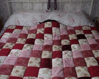 Personalised luxury patchwork quilt in rich reds, creams and pinks. Pink faux suede patches embroidered.