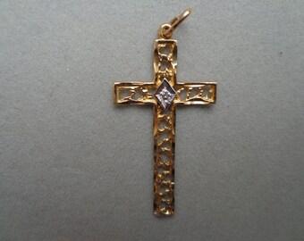 Gold cross ( 10k ) with diamond.