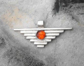 "Sterling silver pendant with an amber cabochon. Complete with an 18"" spiga necklace. Art Deco, Aztec shape"