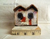 A messy bird house for your shelf..
