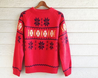vintage 1980s ski sweater in red with classic snowflake design. retro clothing.