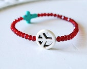 red crystal strech bracelet with peace and cross symbols - stacking bracelet arm party - black orchid