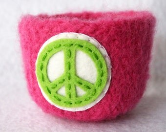 pink wool felted vessel with peace sign
