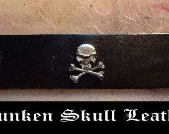 Leather cuff with skull and crossbones
